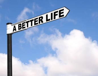 Concept image of a black and white signpost with the words A Better Life against a blue cloudy sky.